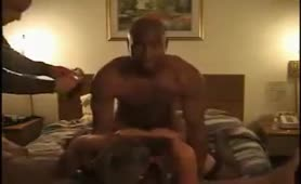 Cuckold sharing his wife with two black men