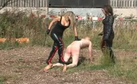 Two strict riding mistresses burn and whip their slave