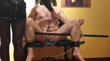 Torturing his cock and balls